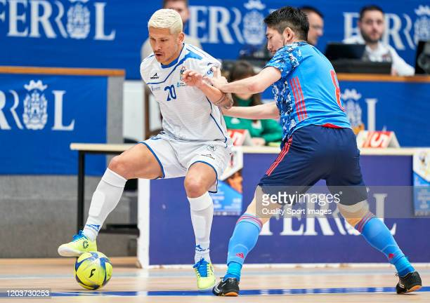 Ryuta Hoshi of Japan competes for the ball with Kaoru Morioka of O Parrulo FS during a friendly match between O Parrulo FS and Japan at Pabellon A...