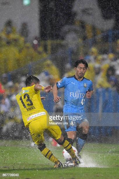 Ryuta Koike of Kashiwa Reysol and Akihiro Ienaga of Kawasaki Frontale compete for the ball during the JLeague J1 match between Kashiwa Reysol and...
