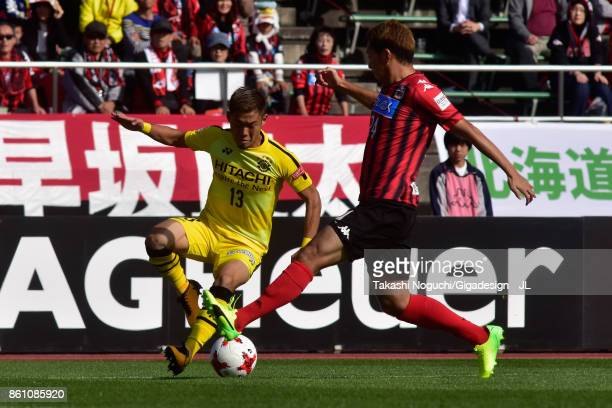 Ryuta Koike of Kashiwa Reysol and Akito Fukumori of Consadole Sapporo compete for the ball during the JLeague J1 match between Consadole Sapporo and...