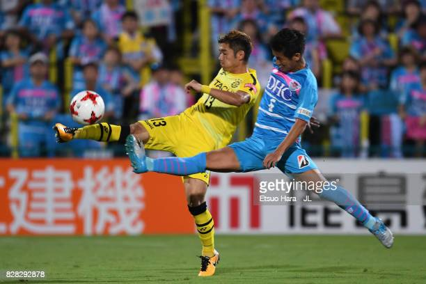 Ryuta Koike of Kashiwa Reysol and Akito Fukuta of Sagan Tosu compete for the ball during the JLeague J1 match between Kashiwa Reysol and Sagan Tosu...