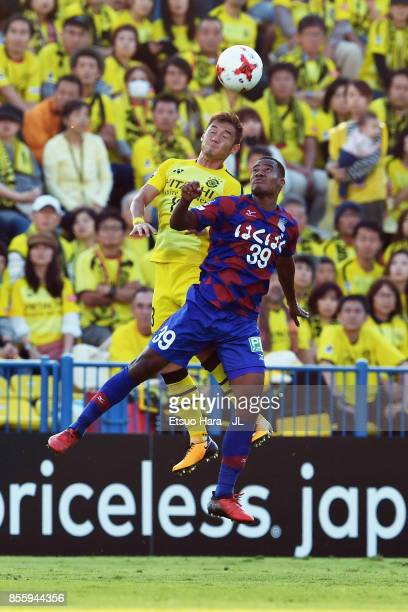 Ryuta Koike of Kashiwa Reysol and Lins of Ventforet Kofu compete for the ball during the JLeague J1 match between Kashiwa Reysol and Ventforet Kofu...