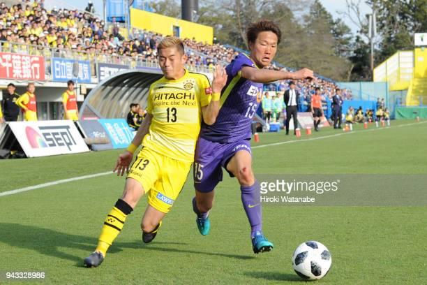 Ryuta Koike of Kashiwa Reysol and Sho Inagaki of Sanfrecce Hiroshima compete for the ball during the JLeague J1 match between Kashiwa Reysol and...