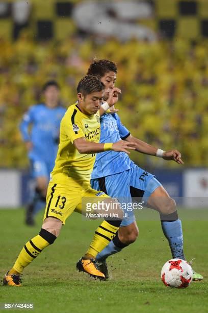 Ryuta Koike of Kashiwa Reysol and Takayuki Morimoto of Kawasaki Frontale compete for the ball during the JLeague J1 match between Kashiwa Reysol and...