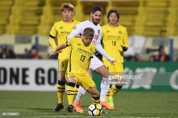 Ryuta Koike of Kashiwa Reysol controls the ball under pressure of Alexandre Pato of Tianjin Quanjian during the AFC Champions League match between...