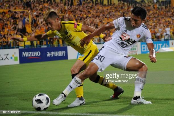 Ryuta Koike#13 of Kashiwa Reysol and Takuma Nishimura#30 of Vegalta Sendai compete for the ball during the JLeague J1 match between Kashiwa Reysol...