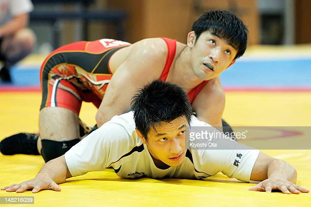 Ryutaro Matsumoto and Kohei Hasegawa of Japan take part in the training session for the Japan Men's wrestling team for the London 2012 Olympic Games...