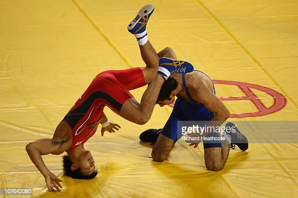 Ryutaro Matsumoto of Japan and Omid Noroozi of Iran in action during the Men's Greco-Roman 60kg Wrestling at Huagong Gymnasium during day nine of the...