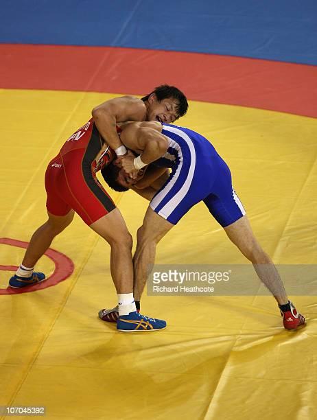Ryutaro Matsumoto of Japan and Sanjarbek Jumashev of Uzbekistan in action during the bronze repechage match of the Men's Greco-Roman 60kg Wrestling...