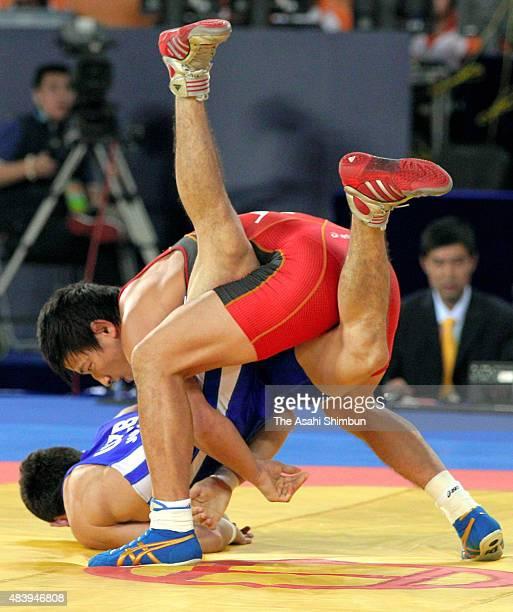 Ryutaro Matsumoto of Japan and Sanjarbek Jumashev of Uzbekistan compete in the Wrestling Men's Greco-Roman -60kg bronze medal match during day nine...