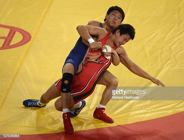 Ryutaro Matsumoto of Japan and Zhen Xie of China in action during the repechage match of the Men's Greco-Roman 60kg Wrestling at Huagong Gymnasium...