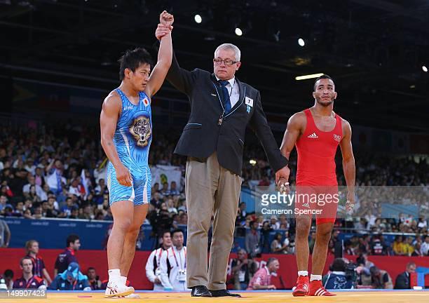 Ryutaro Matsumoto of Japan celebrates winning his bout against Tarik Belmadani of France during the Men's Greco-Roman 60 kg Wrestling 1/4 Final on...