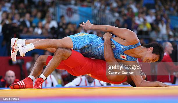 Ryutaro Matsumoto of Japan competes against Tarik Belmadani of France during the Men's Greco-Roman 60 kg Wrestling 1/4 Final on Day 10 of the London...
