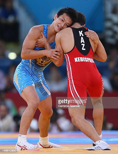 Ryutaro Matsumoto of Japan competes with Almat Kebispayev of Kazakhstan in their Men's Greco-Roman 60 kg Bronze Medal bout on Day 10 of the London...