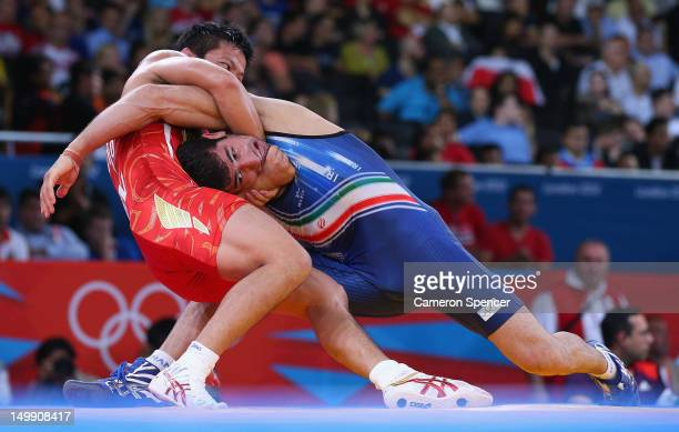 Ryutaro Matsumoto of Japan competes with Omid Haji Noroozi of Islamic Republic of Iran during their Men's Greco-Roman 60 kg Wrestling Semi Final on...