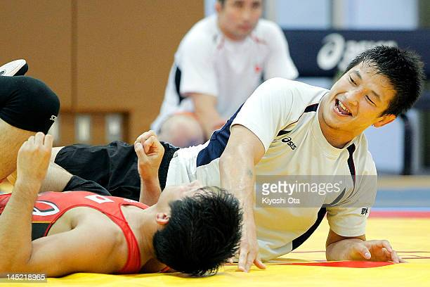 Ryutaro Matsumoto of Japan smiles as he takes part in the training session for the Japan Men's wrestling team for the London 2012 Olympic Games at...