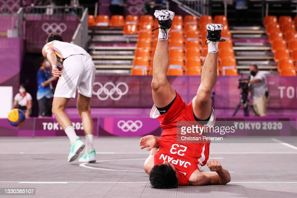 Ryuto Yasuoka of Team Japan falls on the court during the Men's Pool Round match between Belgium and Japan on day one of the Tokyo 2020 Olympic Games...