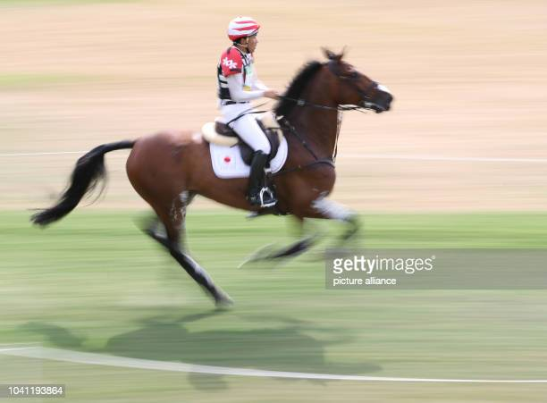 Ryuzo Kitajima of Japan on horse Just Chocolate in action during the Eventing Cross Country of the Equestrian events at the Rio 2016 Olympic Games at...