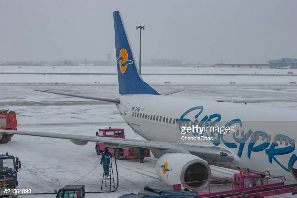rzeszov, poland - refuelling of a eurocypria jet airplane at jasionka airport on a cold snowy winter's day - vertical stabilizer stock pictures, royalty-free photos & images