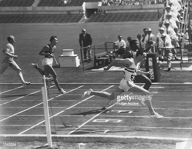S 100 METRES EVENT AT THE OLYMPIC GAMES IN ROME WITH A TIME OF 10.4 SECONDS. F. BUDD OF THE UNITED STATES CAME SECOND. RADFORD WENT ON TO COMPETE IN...