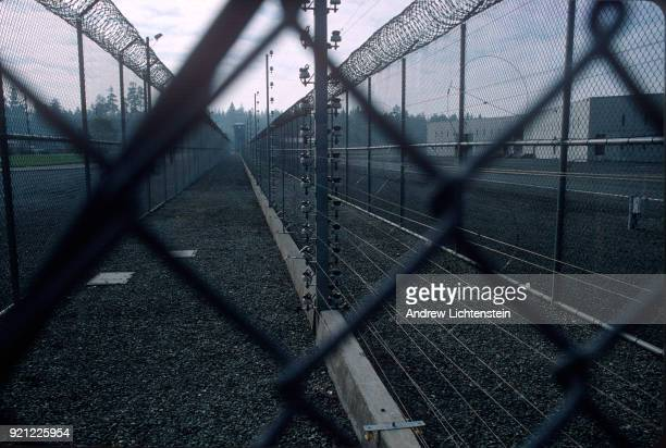 BAY CALIFORNIA CIRCA 1990's A lethal electric fence surrounds the entrance to Pelican Bay prison in the 1990's in Pelican Bay California The prison...