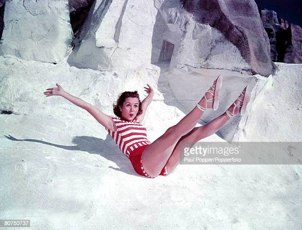 1950's A picture of American Hollywood film actress most famous for her roles in musicaldancing films Debbie Reynolds posing with her legs in the air...