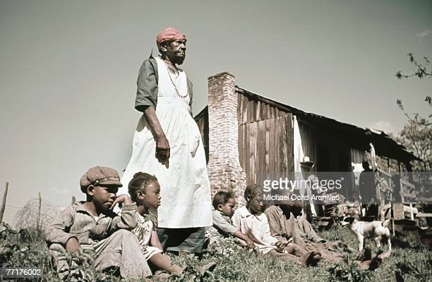MID 1930's A slave family sit outside their house during a recreation of pre Civil War life on a plantation circa mid 1930's in the deep south
