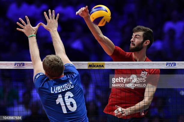 USA's Aaron Russell hits the ball as Serbia's Drazen Luburic tries to block his shot during the 2018 FIVB World Championship bronze medal final 34...