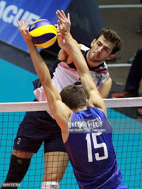 USA's Aaron Russell spikes the ball against Russia's Victor Poletaev during an FIVB World League match at Kay Bailey Hutchison Convention Center in...
