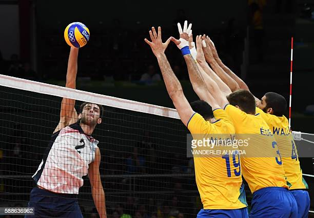 USA's Aaron Russell spikes the ball during the men's qualifying volleyball match between Brazil and the USA at the Maracanazinho stadium in Rio de...
