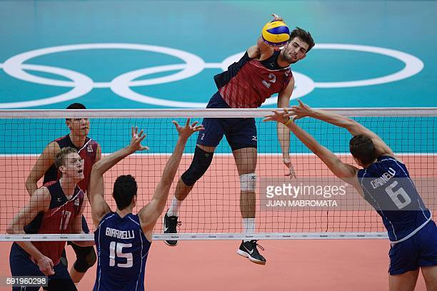 USA's Aaron Russell spikes the ball during the men's semifinal volleyball match between Italy and USA at Maracanazinho Stadium in Rio de Janeiro on...