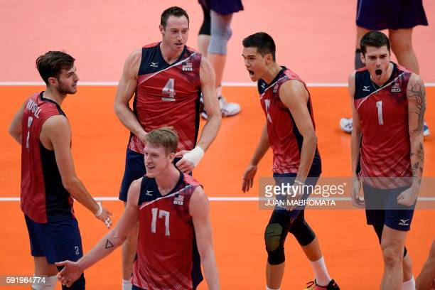 USA's Aaron Russell USA's David Lee USA's Maxwell Holt USA's Micah Christenson and USA's Matthew Anderson celebrate after scoring during the men's...