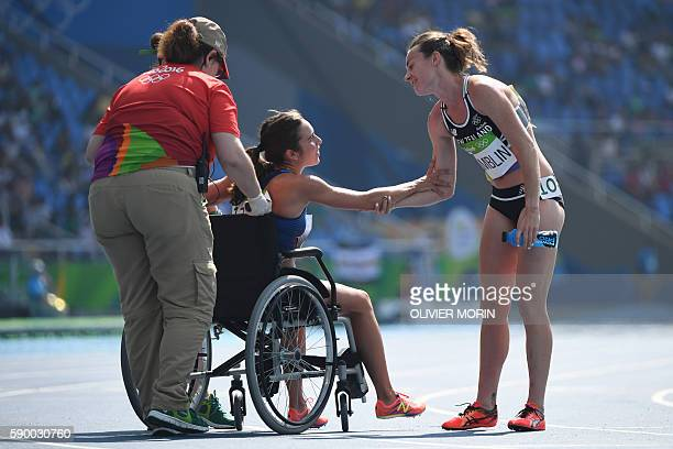 USA's Abbey D'agostino leaves the track on a wheelchair after competing in the Women's 5000m Round 1 during the athletics event at the Rio 2016...
