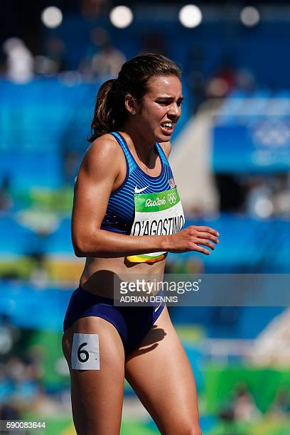 USA's Abbey D'agostino reacts after competing in the Women's 5000m Round 1 during the athletics competition at the Rio 2016 Olympic Games at the...