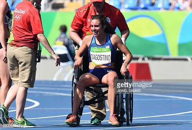 USA's Abbey D'Agostino uses a wheelchair to get off the track after the Women's 5000m Round 1 during the athletics event at the Rio 2016 Olympic...