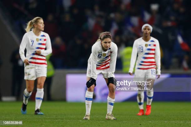 USA's Abby Dahlkemper USA's Morgan Brian and USA's Crystal Dunn react after conceding a goal during a women's friendly football match between France...