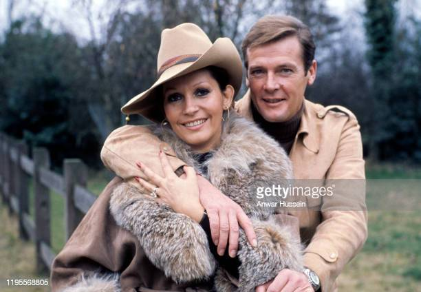 KINGDOM 1970's Actor Roger Moore and wife Luisa Moore pose together in the countryside circa 1970's in England