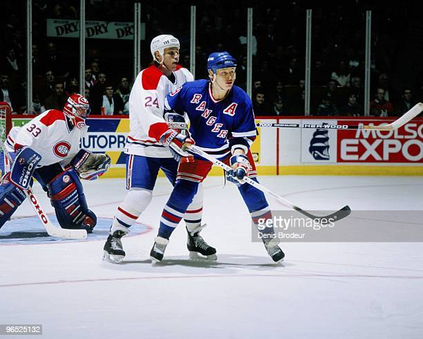 MONTREAL 1990's Adam Graves of the New York Rangers skates against Lyle Odelein of the Montreal Canadiens in the 1990's at the Montreal Forum in...