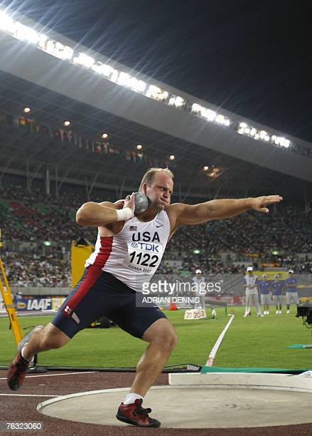 USA's Adam Nelson competes during the mens shot put final 25 August 2007 at the 11th IAAF World Athletics Championships in Osaka USA's Reese Hoffa...