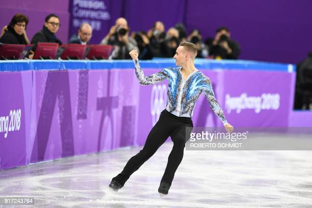 USA's Adam Rippon pumps his fist in front of the judges during his routine in the figure skating team event men's single skating free skating during...