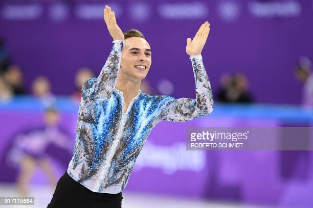 TOPSHOT USA's Adam Rippon reacts after completing his routine in the figure skating team event men's single skating free skating during the...