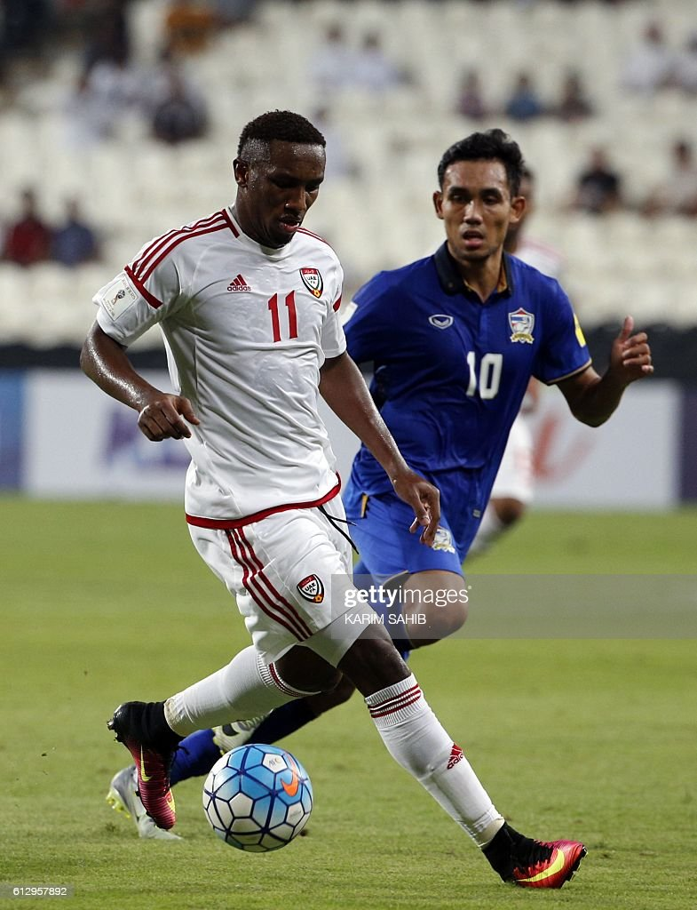 UAE's Ahmed Khalil (L) dribbles by Thailand's Teerasil Dangda during the 2018 FIFA World Cup Qualifiers match between United Arab Emirates and Thailand at the Mohammed Bin Zayed Stadium in Abu Dhabi on October 6, 2016. / AFP / KARIM