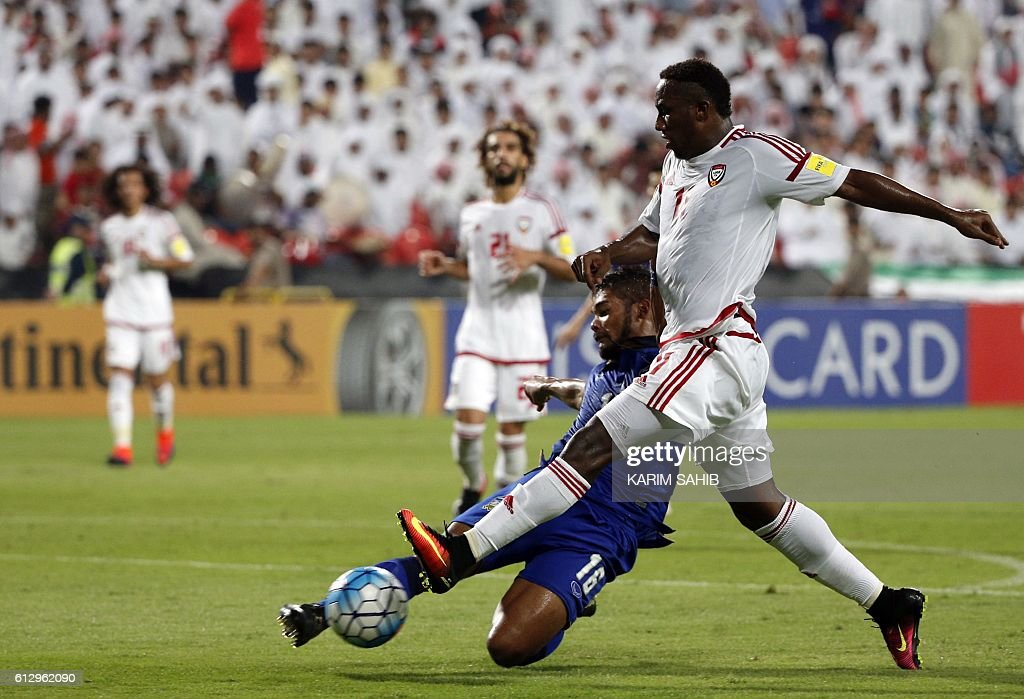 UAE's Ahmed Khalil (R) shoots to score past Thailand's Pratum Chuthong during the 2018 FIFA World Cup Qualifiers match between United Arab Emirates and Thailand at the Mohammed Bin Zayed Stadium in Abu Dhabi on October 6, 2016 / AFP / KARIM