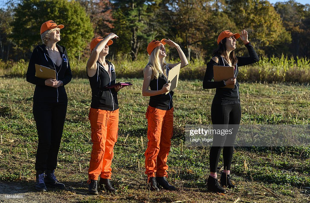 PETA's Air Angels Laura Ray, Lindsay Rajt, Ashley Byrne, and Danielli Marzouca watch a drone in flight as it captures footage in order to monitor illegal hunting practices at Erwin Wilder Wildlife Management Area at on October 21, 2013 in Norton, Massachusetts.