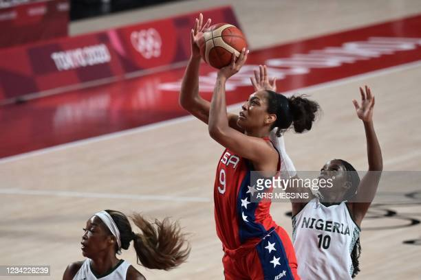 S A'ja Wilson shoots the ball as Nigeria's Promise Amukamara watches in the women's preliminary round group B basketball match between Nigeria and...