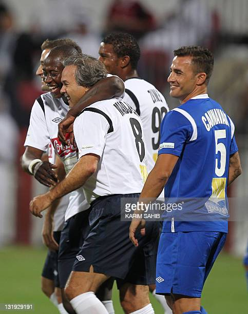 UAE's AlAhli club former player and current technical advisor Fabio Cannavaro of Italy as Algeria's former football player Mustapha Rabah Madjer is...