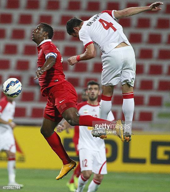 UAE's AlAhli FC Ahmed Khalil competes for the ball against Khaled Shafiei of Iran's Tractor Sazi club during their AFC Champions League group D...