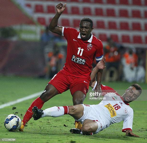 UAE's AlAhli FC Ahmed Khalil is tackled by Ahmad Amirkamdar of Iran's Tractor Sazi club during their AFC Champions League group D football match at...