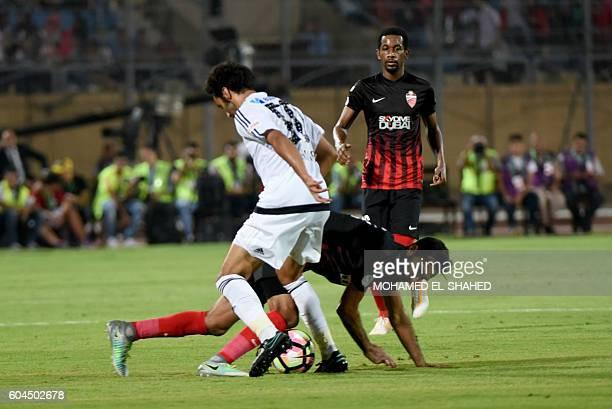 UAE's AlAhli player Alfardan and UAE's AlJazira player Mohamed Gamal vie for the ball during the Arabian Gulf Super Cup match between Emirati teams...