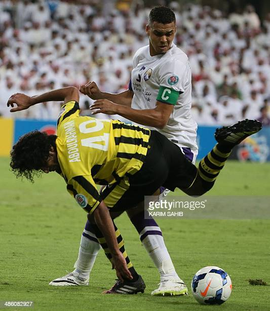 UAE's AlAin captain Ismail Ahmed fights for the ball against Saudi's AlIttihad player Abdulrahman AlGhamdi during their AFC Champions League Group C...