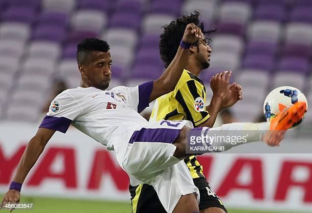UAE's AlAin player Ahmed AlShamisi fights for the ball against Saudi's AlIttihad player Abdulrahman AlGhamdi during their AFC Champions League Group...